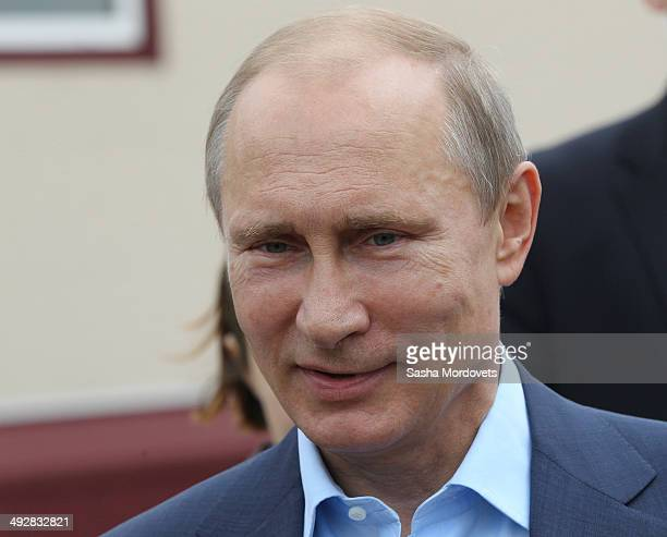 Russian President Vladimir Putin visits a newly built village during a one day visit to Amur region to meet for people whose houses were destroyed...