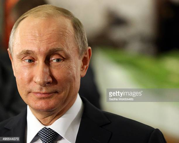 Russian President Vladimir Putin visits an exhibit dedicated to the 2000th annivesrary of the city of Derbent at Russia's Museum of History November...
