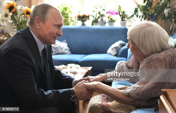 Russian President Vladimir Putin visits human rights activist Lyudmila Alekseyeva chairperson of the Moscow Helsinki Group on the occasion of her...