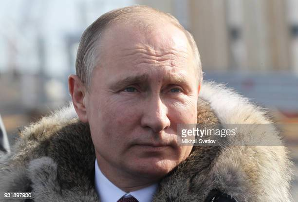 Russian President Vladimir Putin visits the construction site for the Crimean bridge which is being built to connect the Krasnodar region of Russia...