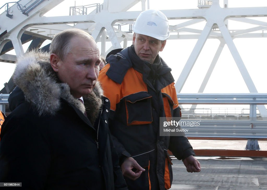 Russian President Vladimir Putin visits the construction site for the Crimean bridge which is being built to connect the Krasnodar region of Russia and Crimean Peninsula across the Kerch Strait on March 14, 2018 on the Taman Peninsula, on the border with Russia and the annexed Ukrainian territory of Crimea.