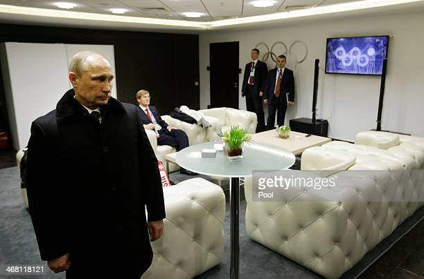 Russian President Vladimir Putin waits in the presidential lounge to be introduced at the opening ceremony of the Sochi 2014 Winter Olympics as a...