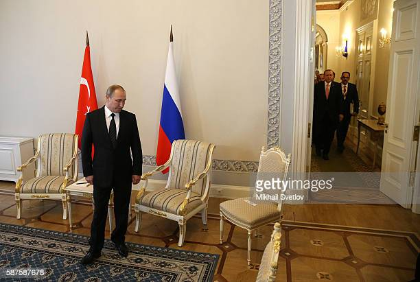 Russian President Vladimir Putin waits to greet Turkish President Recep Tayyip Erdogan during their meeting in Konstantin Palace August 2016 in...