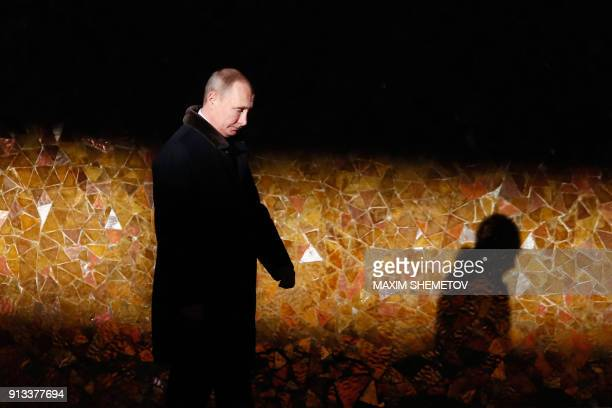 Russian President Vladimir Putin walks as he attends a wreath laying ceremony at the eternal flame of the Mamayev Kurgan memorial complex in the city...