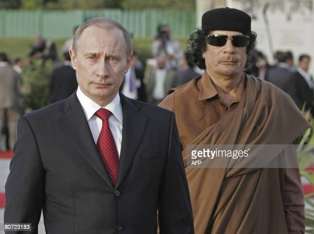Russian President Vladimir Putin walks on April 16 2008 with Libyan leader Moamer Kadhafi in Tripoli Putin arrived in Libya on April 16 2008 for a...