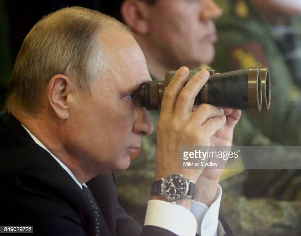 Russian President Vladimir Putin watches a military exercise at a training ground September 18 2017 at Luzhsky range near Saint Petersburg Russia The...