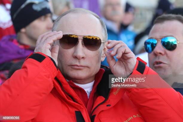 Russian President Vladimir Putin watches the men's 4x10 K crosscountry relay at the 2014 Winter Olympics on February 16 2014 in Krasnaya Polyana...