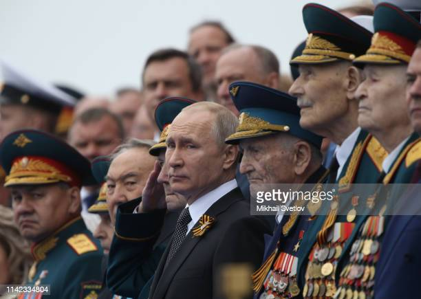 Russian President Vladimir Putin watches the Red Square Victory Day Parade in Moscow Russia May 9 2019 Putin sent his greeting to people of Ukraine...