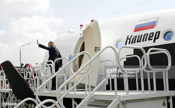 Russian President Vladimir Putin waves after he inspected the first mock-up of the new Russian reusable spacecraft Kliper during the first day of...