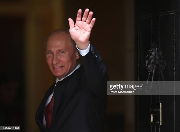 Russian President Vladimir Putin waves as he enters Number 10 Downing Street on August 2 2012 in London England President Putin is visiting the...