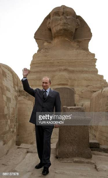 Russian President Vladimir Putin waves as he stands in front of the sphinx in Cairo, 27 April 2005. President Vladimir Putin arrived in Egypt 26...