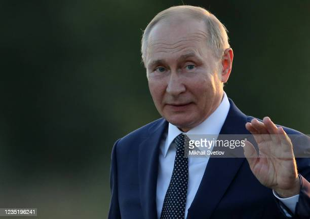 Russian President Vladimir Putin waves during the opening ceremony of the monument to Prince Alexander Nevsky and His Guard at the supposed location...