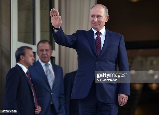 Russian President Vladimir Putin waves goodbye to Israeli Prime Minister after their meeting at the Bocharov Ruchei state residence in Sochi on...