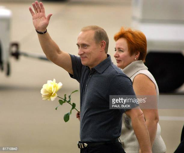 Russian President Vladimir Putin waves to several hundred cheering spectators upon his arrival at Texas State Technical College airport in Waco Texas...