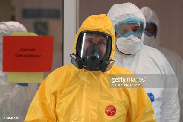 Russian President Vladimir Putin wearing protective gear visits a hospital where patients infected with the COVID19 novel coronavirus are being...