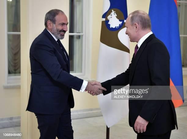 Russian President Vladimir Putin welcomes Armenia's acting Prime Minister Nikol Pashinyan ahead of a meeting of the Supreme Eurasian Economic Council...
