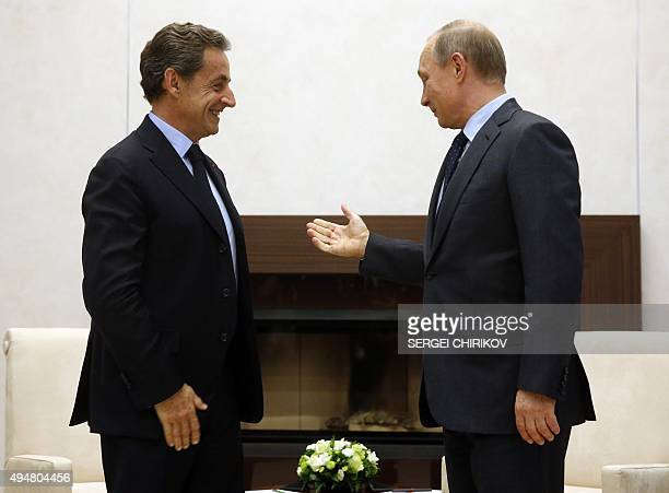 Russian President Vladimir Putin welcomes former French president and President of the rightwing Les Republicains party Nicolas Sarkozy during a...