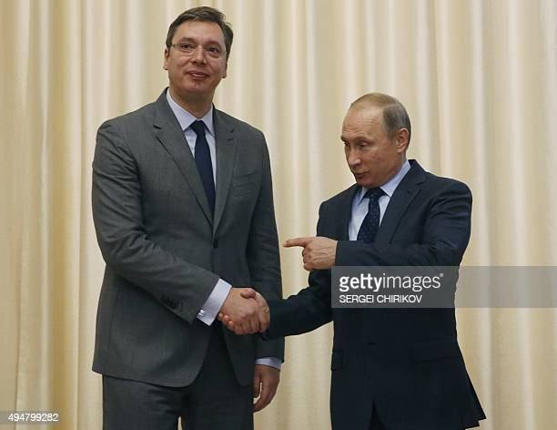 Russian President Vladimir Putin welcomes Serbian Prime Minister Aleksandar Vucic during a meeting at the NovoOgaryovo residence outside Moscow on...