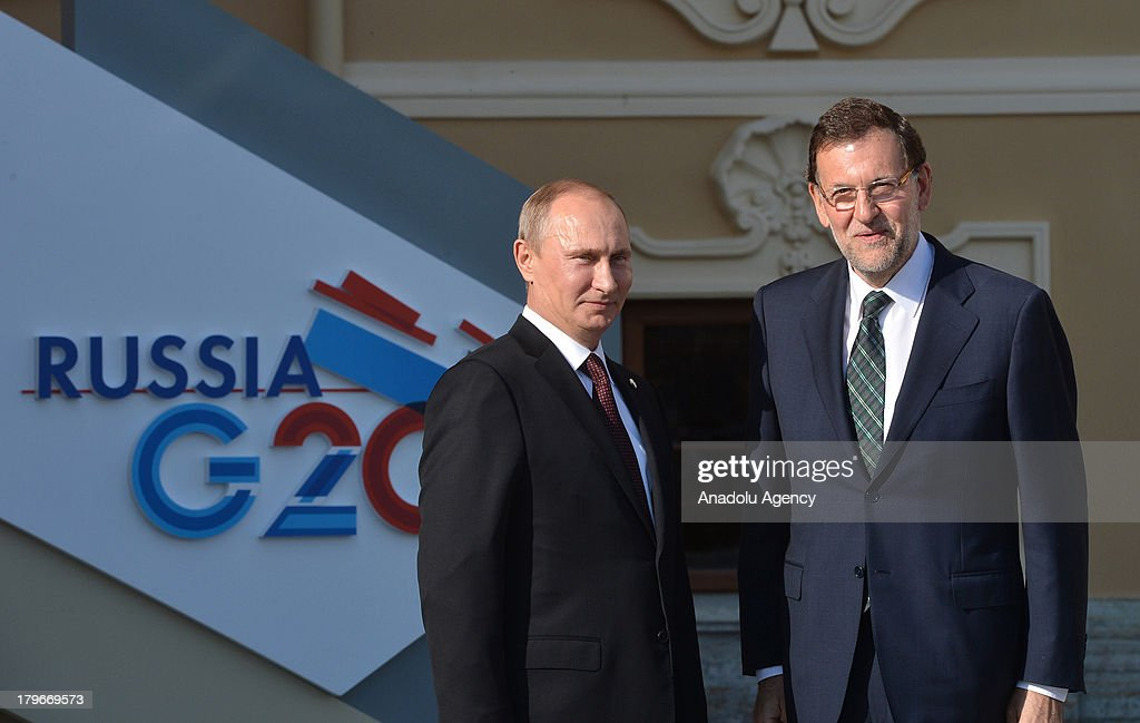 Russian President Vladimir Putin (L) welcomes Spanish Prime Minister Mariano Rajoy (R) during arrivals for the G-20 summit at the Konstantin Palace in St. Petersburg, Russia on September 5,2013. The G20 summit begins on September 5, 2013 in Strelna of Saint Petersburg under Russian Presidency.