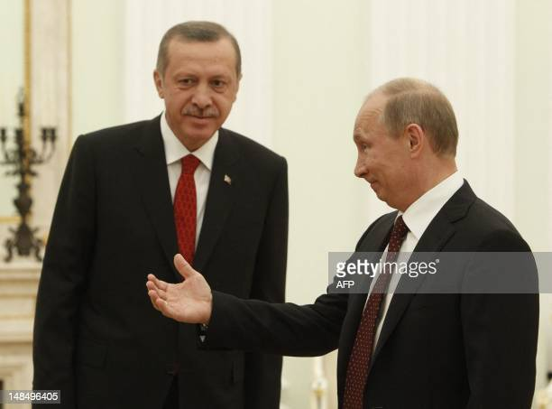 Russian President Vladimir Putin welcomes Turkish Prime Minister Recep Tayyip Erdogan during their meeting to discuss differences on Syria as UN...