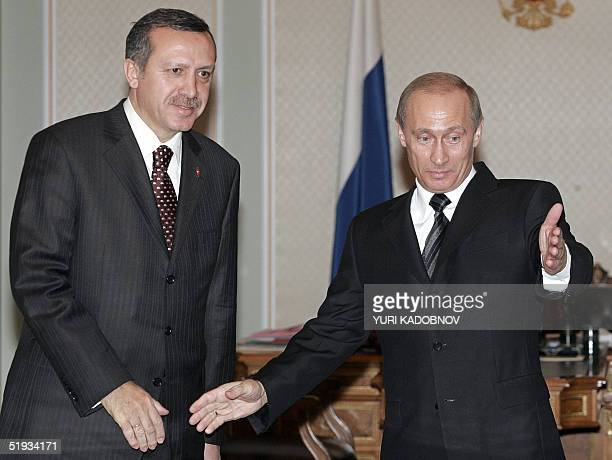 Russian President Vladimir Putin welcomes Turkish Prime Minister Recep Tayyip Erdogan during their meeting in NovoOgaryovo residence outside Moscow...