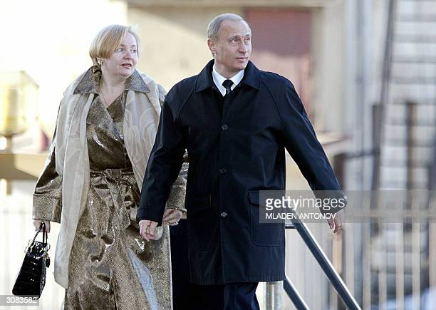 Russian President Vladimir Putin with his wife Ludmila arrives to vote for the Russian Presidential election 14 March 2004 at a polling station in...