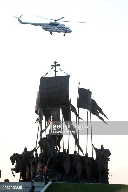 Russian President Vladimir Putin's Mil MI-8 helicopter flies over the monument to Prince Alexander Nevsky and His Guard at the supposed location of...