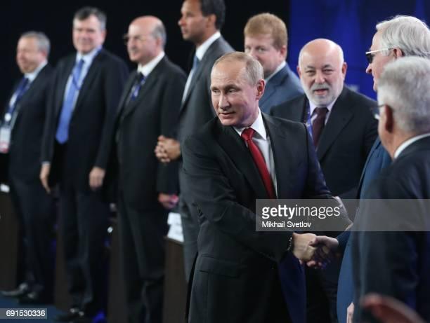 Russian President Vladmir Putin and billionaire Viktor Vekselberg attend the Roundtable RussiaUSA during the Saint Petersburg International Economic...