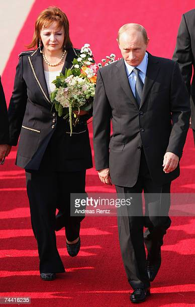 Russian President Wladimir Putin and his wife Ludmila Alexandrowna Putina arrive at the airport on June 6 2007 in RostockLaage Germany Putin along...