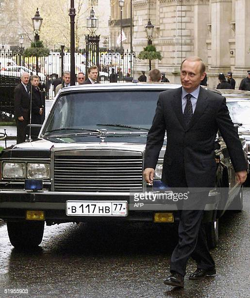 Russian Presidentelect Vladimir Putin followed by his car arrives at N10 Downing street for his talks with British Prime Minister Tony Blair London...