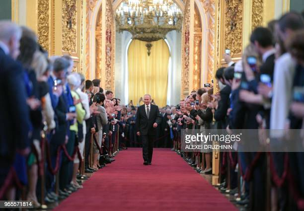 TOPSHOT Russian presidentelect Vladimir Putin walks prior to his inauguration ceremony at the Kremlin in Moscow on May 7 2018