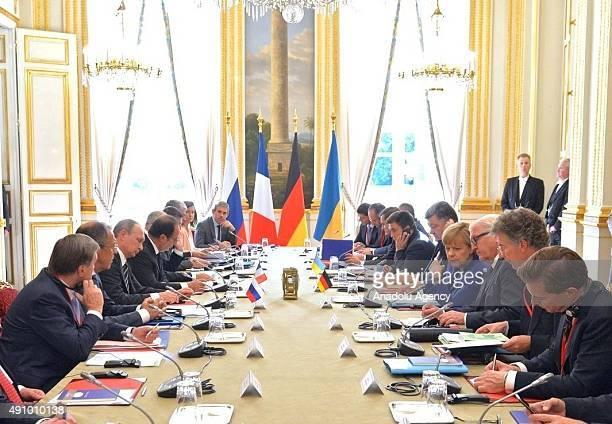 Russian Presidential Aide Yuri Ushakov , Russian Foreign Minister Sergei Lavrov , Russian President Vladimir Putin and French President Francois...