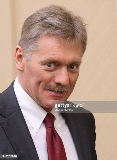 Russian Presidential Press Secretary Dmitry Peskov enters the hall during their weekly meeting with ministers of Russian Governmnet at NovoOgaryovo...