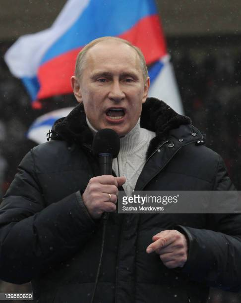 Russian Prime Minister and presidential candidate Vladimir Putin addresses thousands attending a mass rally at the Luzhniki Stadium on February 23...