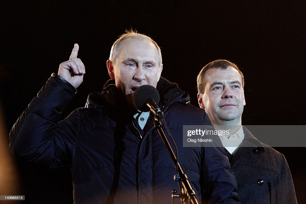 Russian Prime Minister and presidential candidate Vladimir Putin speaks as current President Dmitry Medvedev (R) listens during a rally after Putin claimed victory in the presidential election at the Manezhnya Square March, 4, 2012 in Moscow, Russia. Exit polls showed Putin had over 58 percent of the vote according to state television in an election that has been alleged to be marred by widespread violations.