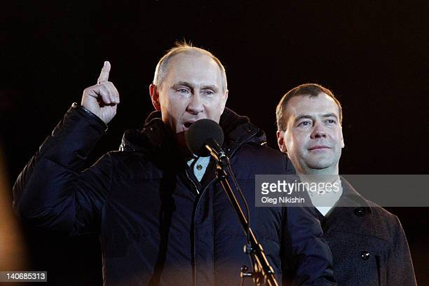 Russian Prime Minister and presidential candidate Vladimir Putin speaks as current President Dmitry Medvedev listens during a rally after Putin...