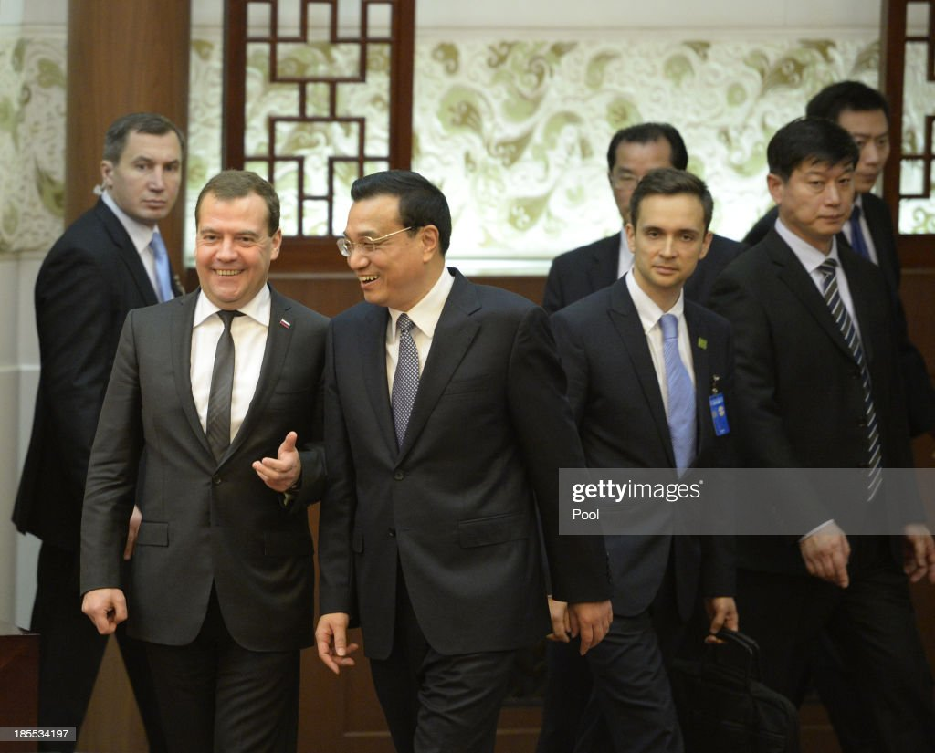 Russian Prime Minister Dmitry Medvedev and Chinese Premier Li Keqiang talk before a signing ceremony at the Great Hall of the People on October 22, 2013 in Beijing, China. Medvedev is in China on a two-day visit as a guest of Chinese Premier Li Keqiang to co-chair the 18th regular meeting between the Chinese and Russian heads of government.