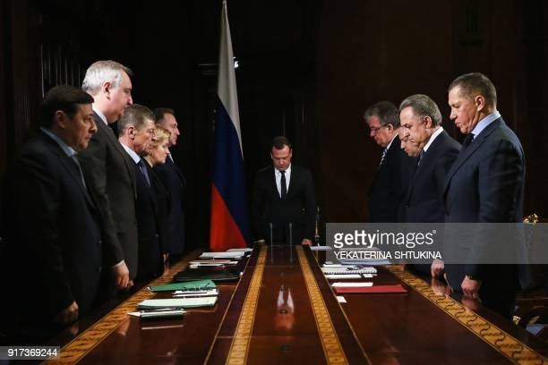 Russian Prime Minister Dmitry Medvedev and Deputy Prime Ministers observe a minute of silence on February 12 2018 in Moscow in tribute to the victims...