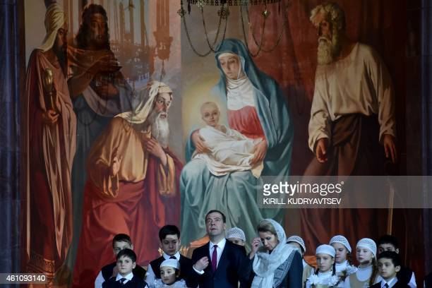 Russian Prime Minister Dmitry Medvedev and his wife Svetlana attend the celebration of a Christmas service in Christ the Savior cathedral in Moscow...