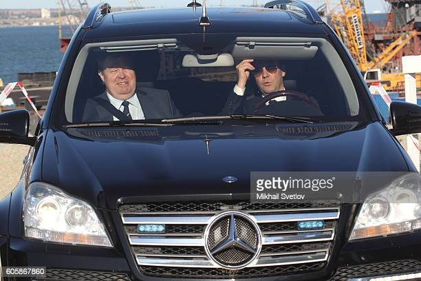 Russian Prime Minister Dmitry Medvedev and Presidential Envoy for Southern Federal District Vladimir Ustinov ride a Mercedes GL while visiting a...