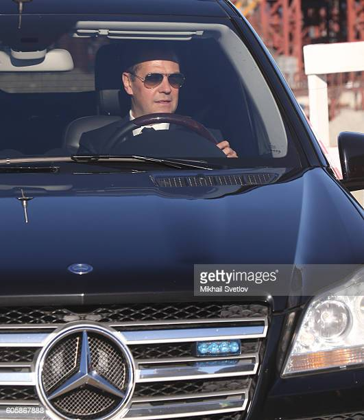 Russian Prime Minister Dmitry Medvedev drives a Mercedes GL while visiting a constructing site of the Kerch Strait Bridge on September 15 2016 in...