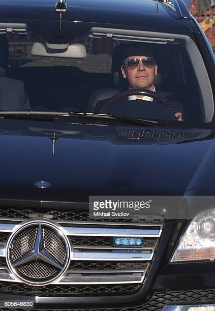 Russian Prime Minister Dmitry Medvedev drives a Mercedes GL while visiting the construction site of the Kerch Strait Bridge on September 15 2016 in...
