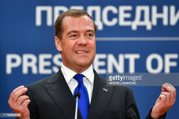 Russian Prime Minister Dmitry Medvedev gestures and reacts during a joint press conference with Serbian President after their meeting in Belgrade, on...