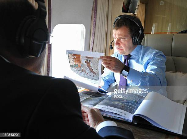 Russian Prime Minister Dmitry Medvedev looks at a map during an observation helicopter flight of the M1 'Belarus' Federal higway outside Moscow on...