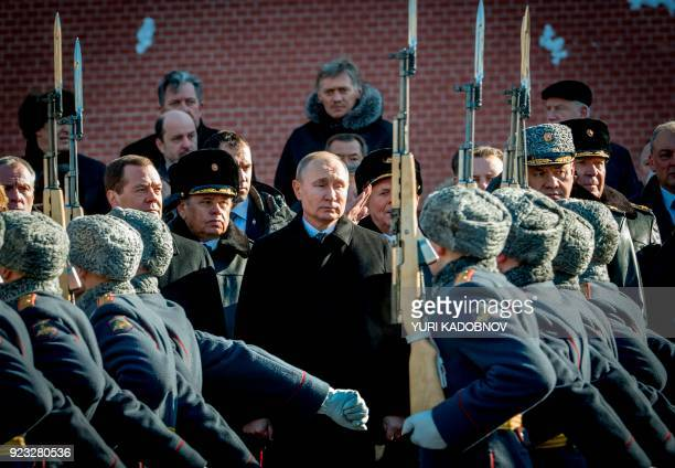 TOPSHOT Russian Prime Minister Dmitry Medvedev Russian President Vladimir Putin and Defence Minister Sergey Shoygu attend a wreath laying ceremony at...