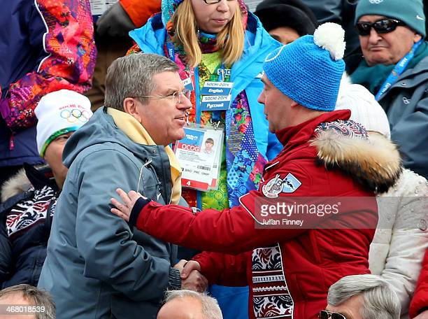 Russian Prime Minister Dmitry Medvedev speaks with International Olympic Committee President Thomas Bach during the Alpine Men's Downhill on day two...