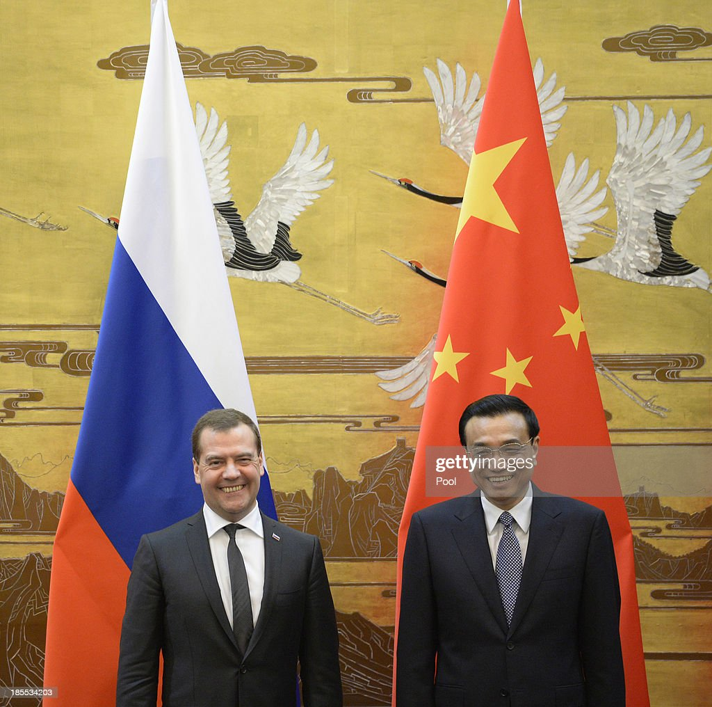 Russian Prime Minister Dmitry Medvedev talks with Chinese Premier Li Keqiang during a signing ceremony at the Great Hall of the People on October 22, 2013 in Beijing, China. Medvedev is in China on a two-day visit as a guest of Chinese Premier Li Keqiang to co-chair the 18th regular meeting between the Chinese and Russian heads of government.
