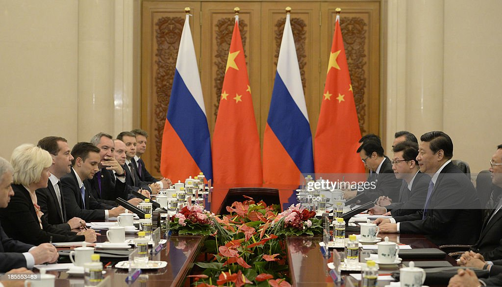 Russian Prime Minister Dmitry Medvedev (3rd, L) talks with Chinese President Xi Jinping (2nd, R) during a meeting at the Great Hall of the People on October 22, 2013 in Beijing, China. Medvedev is in China on a two-day visit as a guest of Chinese Premier Li Keqiang to co-chair the 18th regular meeting between the Chinese and Russian heads of government.