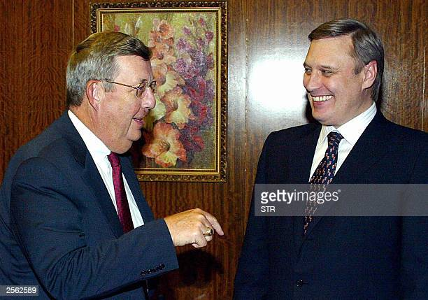 Russian Prime Minister Mikhail Kasyanov speaks with Exxon Mobil Corp's Chairman and Chief executive Lee Raymond during their meeting in Moscow 03...
