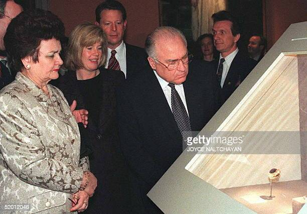 Russian Prime Minister Viktor Chernomyrdin admires a sapphire brooch during a tour of the Jewels of the Romanovs with his wife Valentina US Vice...